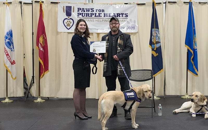 Heidi Faulkner officially presents Jeff with service dog Annie