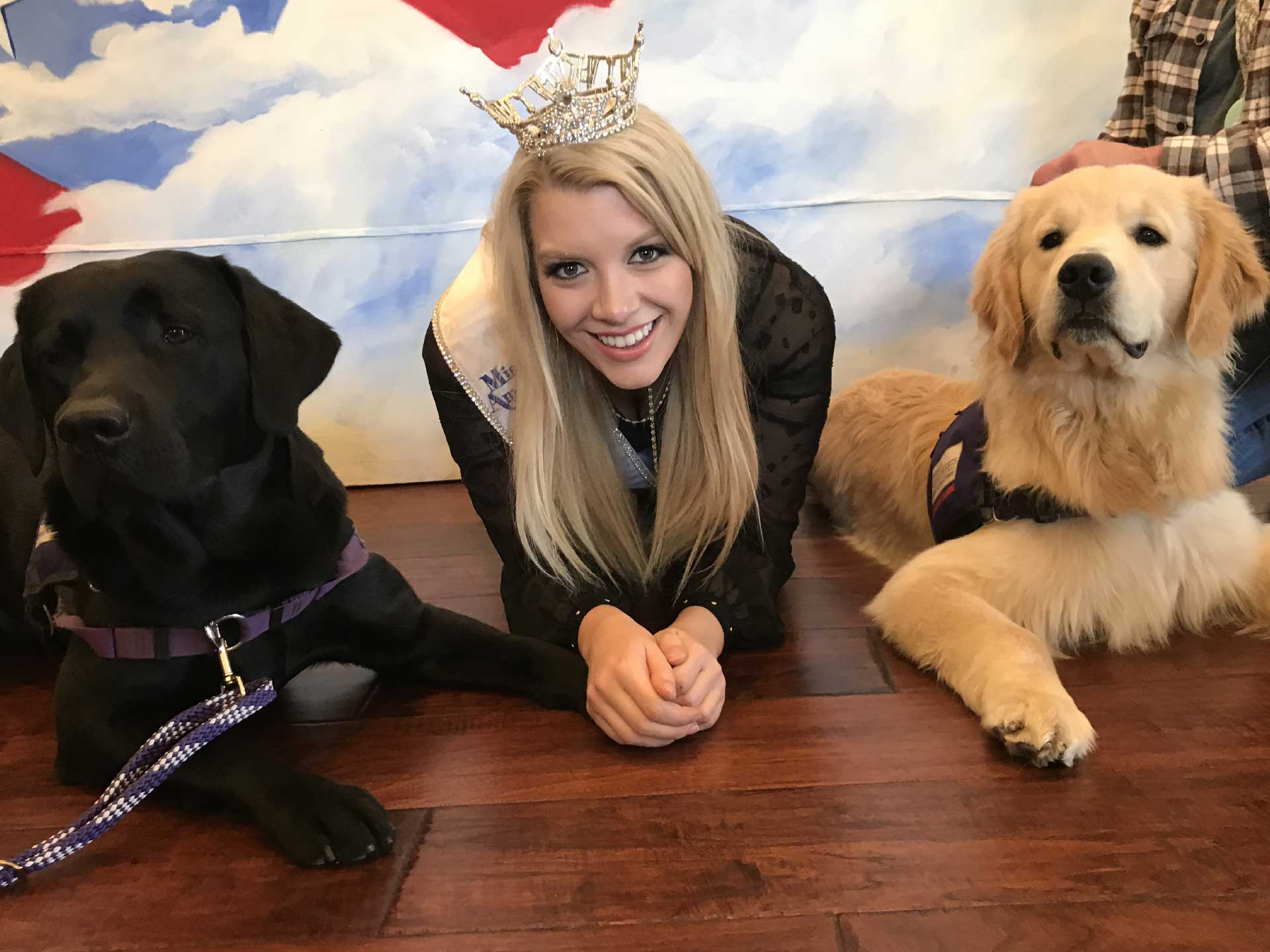 Miss California visits with Timmy and Ozzy.