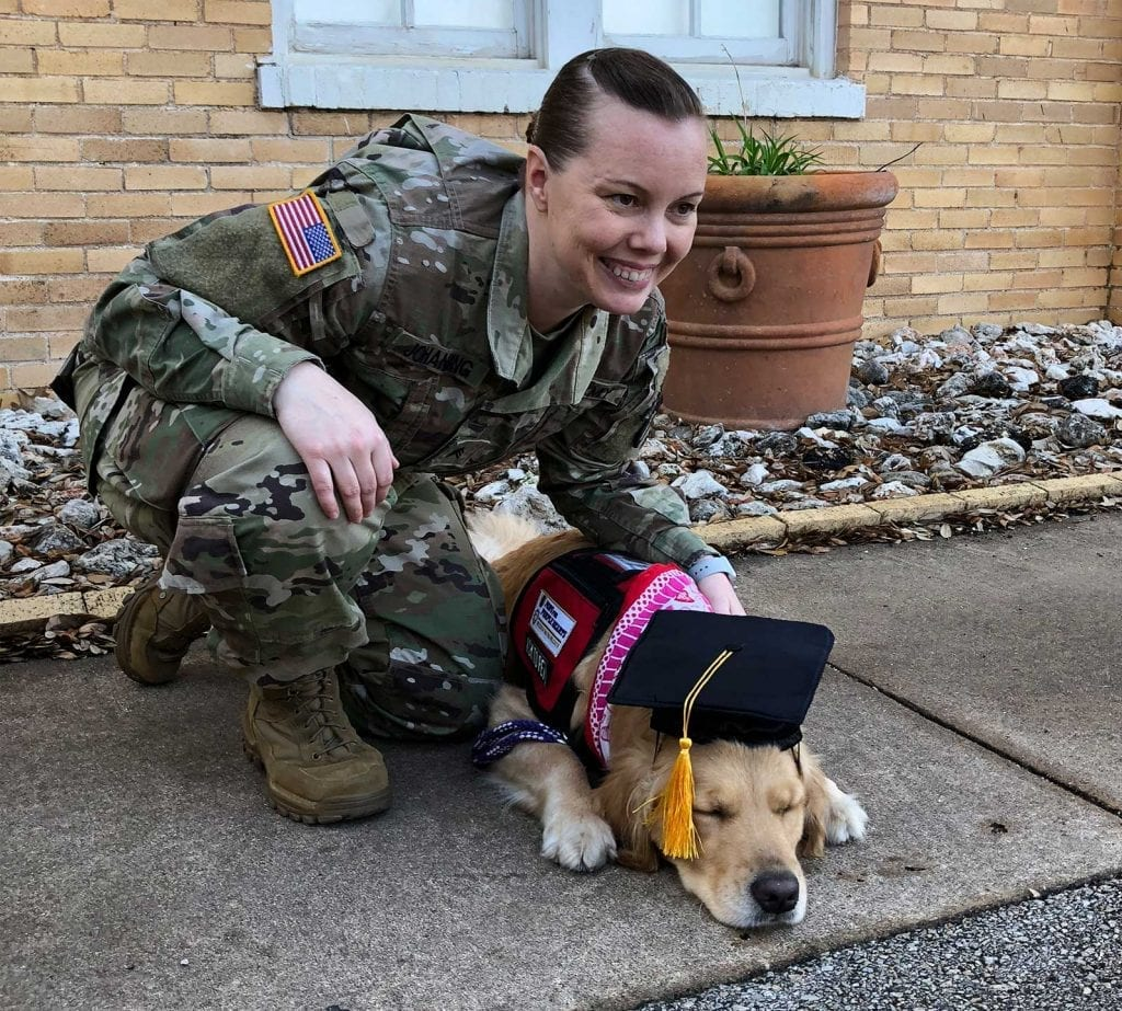 Texas Military Department SHARP Team Handler poses with Patsy after their graduation!