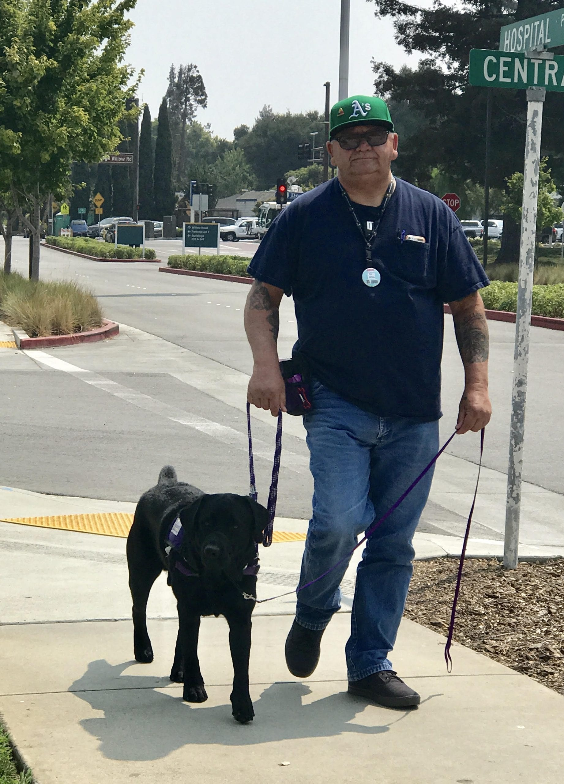 Timmy training on VA grounds with his Veteran.