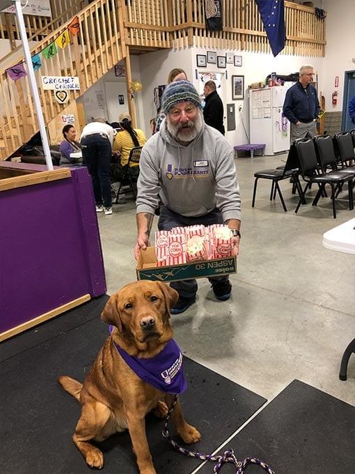 Service Dog in Training Cheechako resists the temptation of fresh popcorn