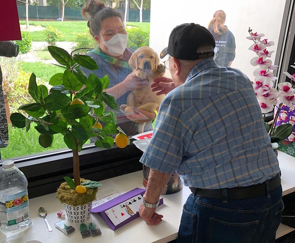 Arri visits a Veteran at the Menlo Park VA