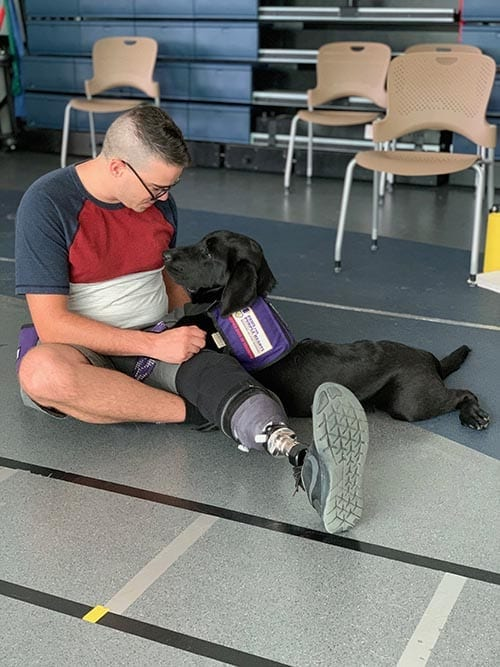 PPH Riley bonds with Warrior during Canine-Assisted Warrior Therapy in San Antonio