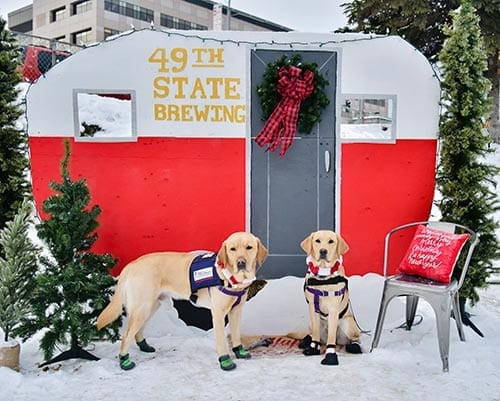 Andi and Reagan wearing protective booties during a Christmas festival