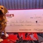 Rosie's Gaming Emporium presented Scout and the Virginia Team a $2,500 check. Photographer: Danielle Stockbridge
